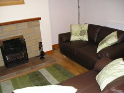 Lounge and Dining area at Springwell Cottage Glen Nevis Fort William